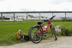 Travel of bicycle. Two bicycle on the road in front of field stock photo