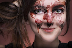 Travel birthmark. Close up of a beautiful female face with a great world shaped birthmark Stock Images
