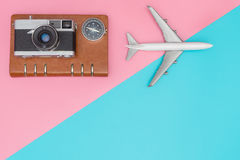 Travel blogger objects on pink and blue. Copy space Stock Photography