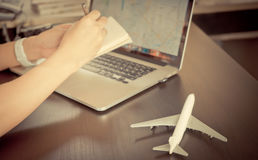 Travel Blogger is planning his trip using Internet Map Stock Photos