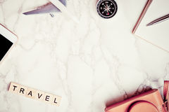 Travel blogger writer accessories on luxury white marble Stock Image