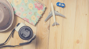 Travel blogger writing stuffs on wooden table. Royalty Free Stock Photo