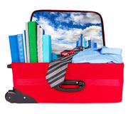 Travel blue business suitcase packed for trip. Travel blue business suitcase. Packed for official journey. Personal belongings: books, tie, shirt, toothbrush Stock Image