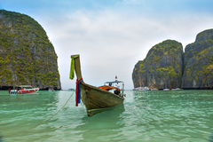 Travel boat and cloudy sky. Travel boat wait for traveler who come to maya bay phiphi island krabi Stock Images