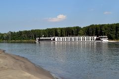 Travel by boat cruise on the Danube(2). Cruise on the Danube River in early summer. The waves hit the shores power stock images