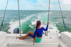 Travel boat excursion tour woman tourist relaxing on deck of motorboat catamaran, Florida, USA summer. Vacation stock photo