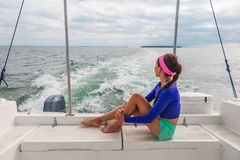 Travel boat excursion tour woman tourist relaxing on deck of motorboat catamaran summer. Vacation stock image