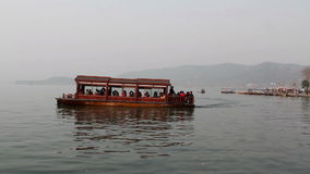 Travel boat float at the West Lake in Hangzhou stock footage