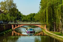 Travel boat in Strasbourg . Reflections in the river Ill Royalty Free Stock Images