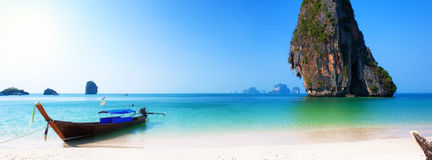 Travel boat on Thailand island beach. Tropical coast Asia landscape background