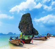 Travel boat on Thailand island beach. Tropical coast Asia landscape background royalty free stock images