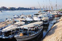 Excursion boats on Luxor, Nile river. Egypt. Travel boats lined along the Nile River are waiting for their passengers. Luxor, Egypt Stock Photos