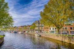 Travel Boats In One of the Multiple Channels of Harlem City in The Netherlands Stock Photos