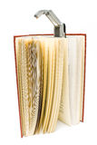 Travel book lamp on red hardcover book Royalty Free Stock Images