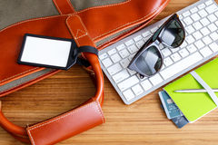 Travel booking and planning concept with blank bag tag. And traveling accessories royalty free stock photography