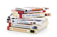 Travel books. Various travel books on the American Southwest, Canada and Washington state on white background royalty free stock photo