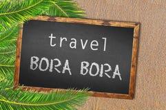 Travel Bora Bora palm trees and blackboard on sandy beach Royalty Free Stock Images