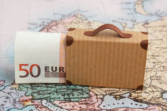 Travel budget. Concept with 50 euro note and suitcase on map Royalty Free Stock Photography
