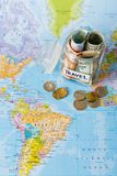 Travel budget concept. Money saved for vacation in glass jar on map. Travel budget concept. Money saved for vacation in glass jar on world map background, top Stock Photos