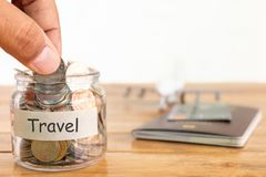 Travel budget concept. Travel money savings concept. Collecting money in the money jar for travel. Money jar with coins, aircraft. royalty free stock photography