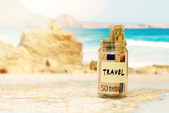 Travel budget concept, money savings in a glass jar Royalty Free Stock Images