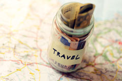 Travel budget concept, money savings in a glass jar Royalty Free Stock Photos