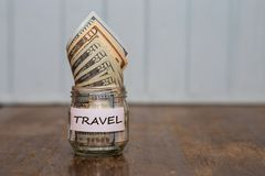Travel budget concept. Travel money savings in a glass jar Royalty Free Stock Photography