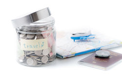 Travel budget concept. travel money savings in a glass jar. Stock Photography