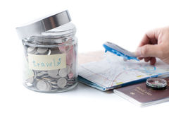 Travel budget concept. travel money savings in a glass jar. Royalty Free Stock Photo