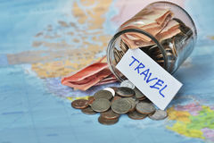 Travel budget concept. travel money savings in a glass jar Royalty Free Stock Images