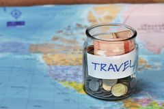 Travel budget concept. travel money savings in a glass jar Stock Photography