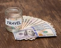 Travel budget concept. Travel money savings in glass jar Royalty Free Stock Photography