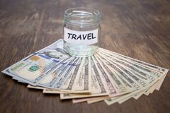 Travel budget concept. Travel money savings in glass jar Stock Photography