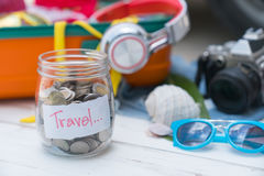 Travel Budget - Save Money On Vacation In A Bottle Of Glass Royalty Free Stock Photos