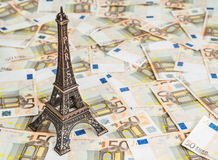 Travel budget to Europe. Travel budget concept with copy space. Eiffel Tower souvenir and vacation money. Savings for trip to France Stock Images