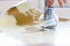 Travel budget - vacation money savings in a glass jar Stock Image