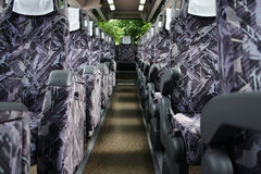 Travel by bus. Purple seat in a bus Royalty Free Stock Image