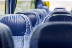 Travel bus interior and seats. Transport, tourism, road trip and equipment concept - travel bus interior and seats Stock Photo