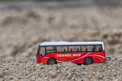 Travel bus toy. Travel bus, toy for kids in the sand. Shallow depth of field Stock Photography