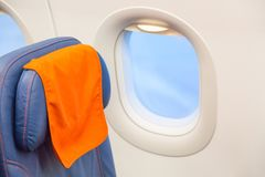 Travel or business trip concept. Blue airplane empty seat with windows. Aircraft interior. Travel or business trip concept. Blue airplane empty seat with royalty free stock photos