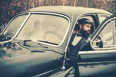 Travel and business trip or hitch hiking. Bearded man and sexy woman in car. Escort of girl by security. Couple in love. Travel and business trip or hitch hiking stock images