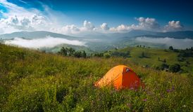 Travel camping tent on a summer meadow Royalty Free Stock Images