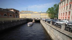 Travel on canals of St. Petersburg Film Tilt. View of the Triple Bridge and the Griboyedov Canal in St. Petersburg stock footage