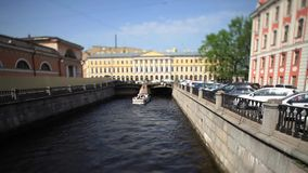 Travel on canals of St. Petersburg time Lapse Film Tilt. View of the Bridge and the Griboyedov Canal in St. Petersburg stock footage