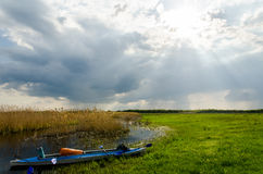 Travel by canoe in a storm Stock Images
