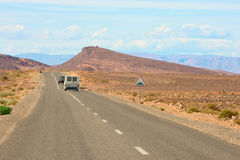 Travel by car. Long way from Sahara to mountains by car Royalty Free Stock Photography