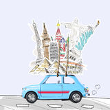 Travel by car. Around the world travel memories. Blue retro toy car with famous monuments on roof Royalty Free Stock Photography
