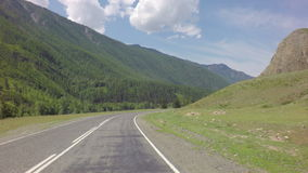 Travel by car on the Chuysky Trakt in Altai Mountains. Travel by car on the Chuysky Trakt in the Altai Mountains stock footage