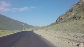 Travel by car on the Chuysky Trakt in Altai Mountains. stock footage