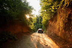 Travel by car on a dirt road, Sunny light Stock Photo